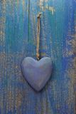Rustic heart on turquoise/blue wooden surface for valentine, bir Royalty Free Stock Image