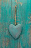 Rustic heart on turquoise wooden surface for valentine, birthday royalty free stock images