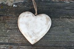 Rustic heart on wooden background. Old style heart on wooden background royalty free stock photography
