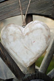 Rustic heart on the wooden wheel Stock Image