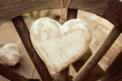 Rustic heart on the wooden wheel Royalty Free Stock Photo