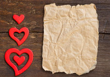 Rustic hearts on a wooden background Royalty Free Stock Image