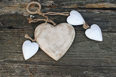 Rustic hearts on the wooden background. Old style hearts on wooden background royalty free stock photo