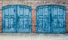 Rustic Heavy Wooden Doors. A Pair Of Heavy Old Doors On An Old Mews Or Street Of Stables Or Row Of Carriage Houses royalty free stock image