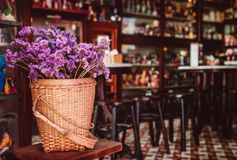 Rustic home decor style. Bouquet of dried field flowers in bambo. Rustic home decor, country style. Lavender bouquet of dried field flowers in bamboo basket on Royalty Free Stock Photography