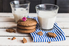 Rustic home made cookies on the wooden background with milk Royalty Free Stock Image
