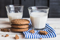 Rustic home made cookies on the wooden background with milk Stock Photo