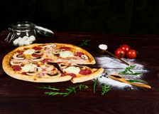 Rustic home made mushroom pizza royalty free stock image