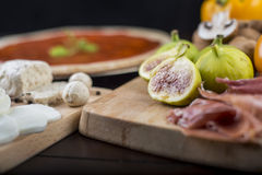 Rustic home made pizza ingredients Royalty Free Stock Image