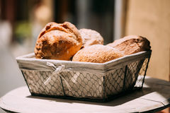 Rustic homemade bread in basket on an old vintage Stock Image