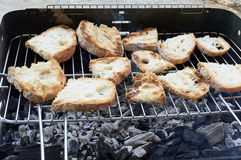 Rustic homemade bread sliced, roasted on the grill Stock Images