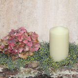 Rustic homemade christmas decoration with hydrangea and candle Royalty Free Stock Photography