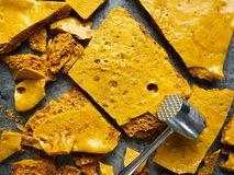 Rustic homemade golden honeycomb toffee. Close up of rustic homemade golden honeycomb toffee stock image