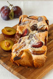 Rustic homemade plum cake. Homemade cake made with fresh autumn plums Stock Images
