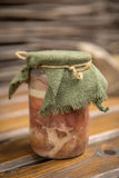 Rustic homemade pork stew. On wooden boards stock photography