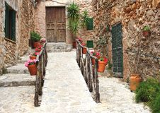 Rustic Mediterranean alleyway with flowers and plants Stock Photos