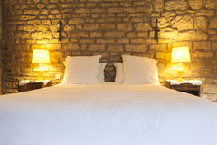 Rustic hotel bedroom Stock Images