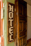 Rustic hotel entrance sign Stock Images