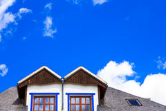 Rustic house and blue sky Royalty Free Stock Images