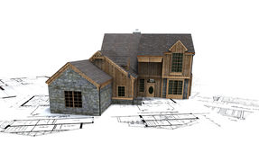 Rustic house on blueprints Royalty Free Stock Photography