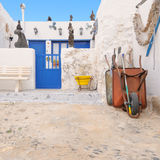 Rustic house in Caleta de Sebo, Graciosa, Canaries. A rustic house in Caleta de Sebo, La Graciosa island, Canary Islands, Spain; whitewashed walls, blue doors Royalty Free Stock Images