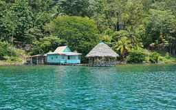 Rustic house with hut over water Panama Royalty Free Stock Photography
