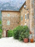 Rustic house with a patio and flowerpots, Deia, Mallorca Royalty Free Stock Photography
