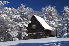 Rustic house in snow Stock Image