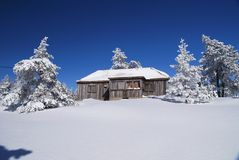 Rustic house in snow Royalty Free Stock Photo