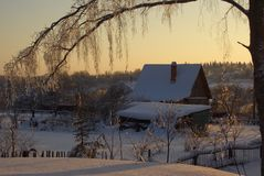 Rustic house in the snow in the evening light. Rustic house in the snow in the soft evening light Royalty Free Stock Photography