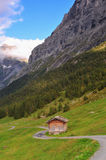 Rustic House under mountain Stock Images