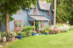 Rustic house in woods Stock Photos