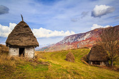 Rustic houses. Fall on Bedeleu Mountains, Alba county, Romania, Rustic house on the mountains. Used by villagers all summer when they go up in the mountains with Royalty Free Stock Photos