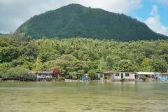 Rustic houses lush shore Huahine French Polynesia Stock Photos