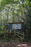 Rustic hut in the forest Royalty Free Stock Photos
