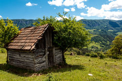 Rustic hut 3. Rustic hut, on the top of the Bedeleu mountain, used by peasants in the summers to keep their animals there over nights Stock Photography