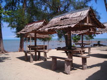 Rustic huts by the beach at Bintan, Indonesia. Forgotten era Stock Image