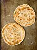 Rustic indian roti prata Stock Photo