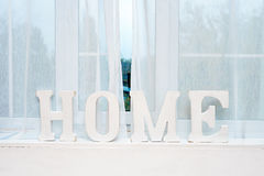 Rustic interior decor. Word Home on windowsill. Rustic interior decor. Word Home on windowsill Royalty Free Stock Photography