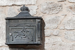 Rustic iron mailbox on a stone wall.  Stock Photography