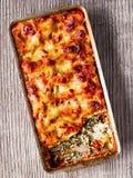 Rustic italian baked spinach ricotta cannelloni pasta Stock Photo