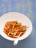 Rustic italian calamari in spicy tomato sauce Royalty Free Stock Photography