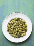 Rustic italian gnocchi in pesto sauce Royalty Free Stock Photo