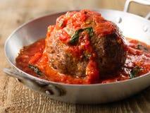 Rustic italian meatball in tomato sauce Stock Photo