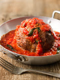 Rustic italian meatball in tomato sauce. Close up of rustic italian meatball in tomato sauce Royalty Free Stock Photo