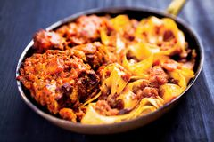 Rustic italian oxtail ragu pappardelle pasta. Close up of rustic italian oxtail ragu pappardelle pasta Royalty Free Stock Photos