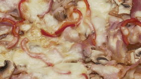 Rustic italian pizza with ham, kaiser, mozzarella and mushrooms stock video
