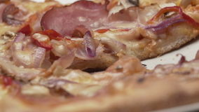 Rustic italian pizza with ham, kaiser, mozzarella and mushrooms stock video footage