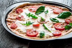Rustic italian pizza with mozzarella, cheese and basil Royalty Free Stock Image