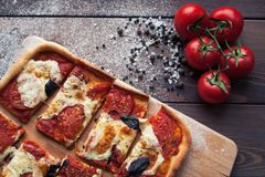 Rustic italian pizza with mozzarella, cheese and basil leaves. Vegetarian food stock image